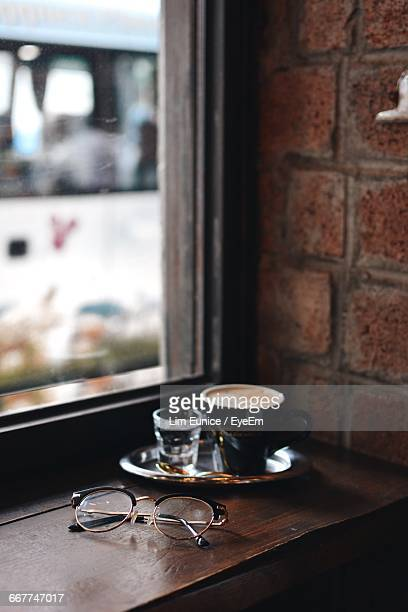 Coffee Cup And Eyeglasses On Table