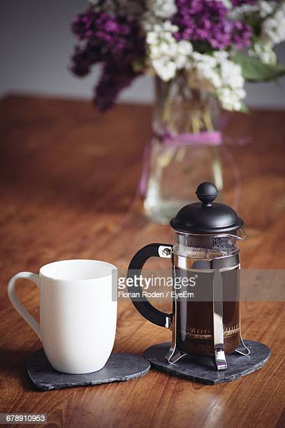 Coffee Cup And French Press On Table