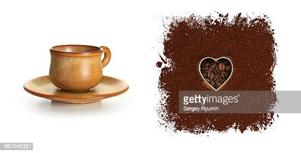 Coffee cup and heart shape. Isolated on white.