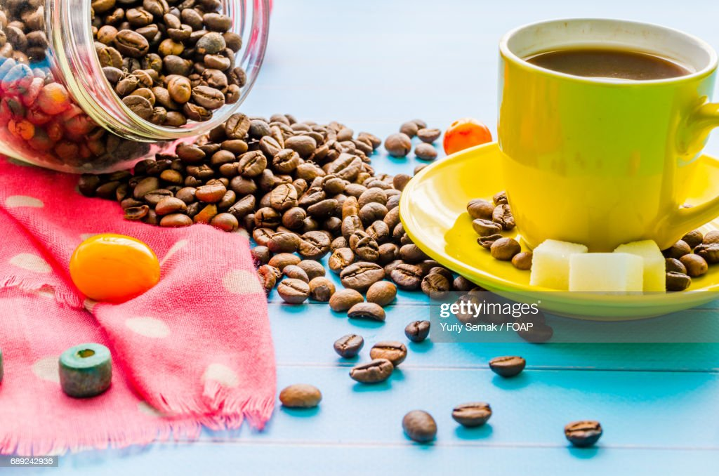 Coffee cup and jar of coffee beans : Stock Photo