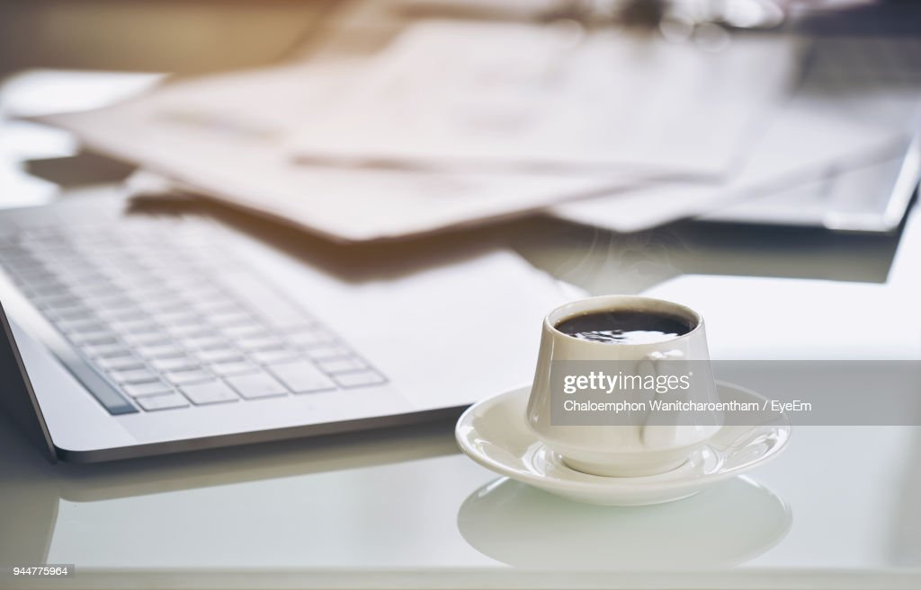 Coffee Cup By Laptop On Table : Stock Photo