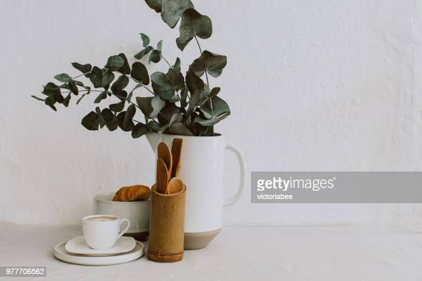 coffee cup, croissant, kitchen utensils and eucalyptus in a jug - eucalyptus tree stock pictures, royalty-free photos & images