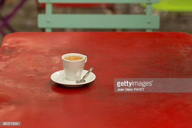 coffee cup on a old iron red table - jean marc payet stock pictures, royalty-free photos & images