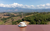 cup coffee balcony with blurred mountainous