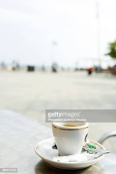 Coffee cup on outdoor cafe table