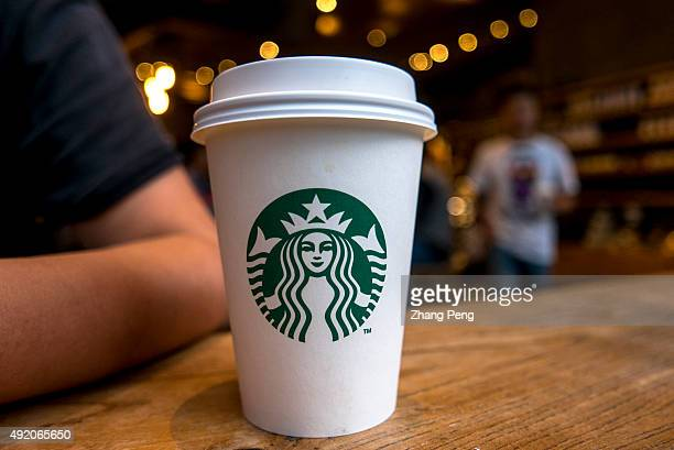 Coffee cup on table in a Starbucks cafe Starbucks is streamlining the ordering process so customers are able to get that cup of coffee faster than...