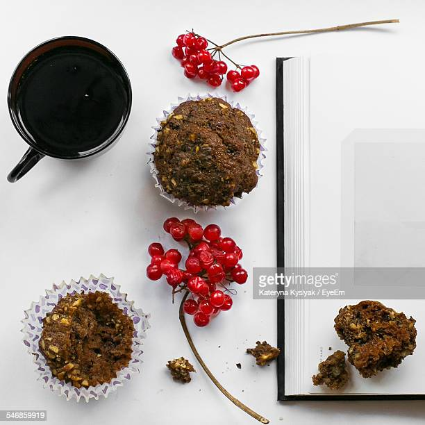 Coffee Cup Served With Muffins And Red Berries