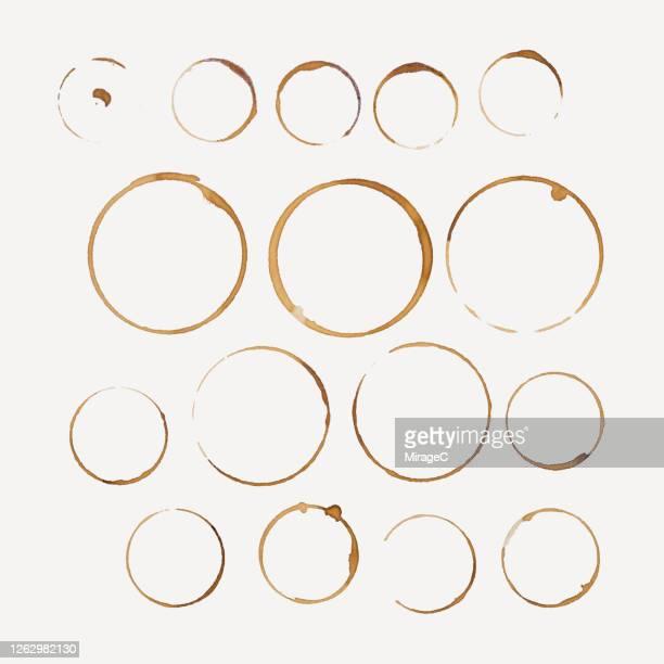 coffee cup stains collection on beige - schmutzfleck stock-fotos und bilder