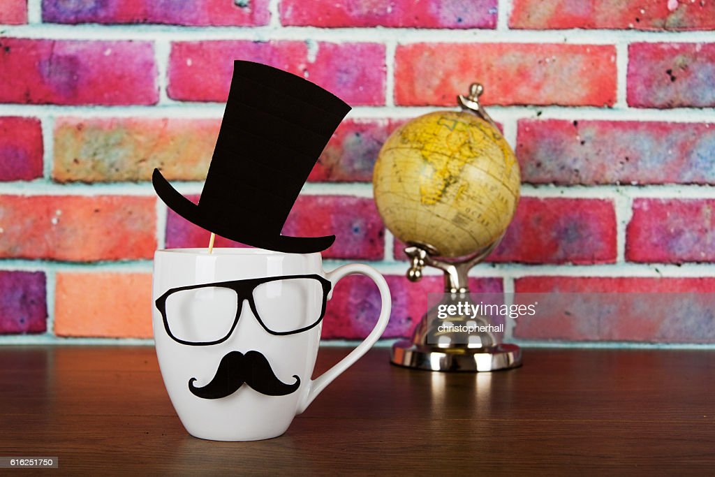 Coffee cup with a black hipster mustache : Foto de stock
