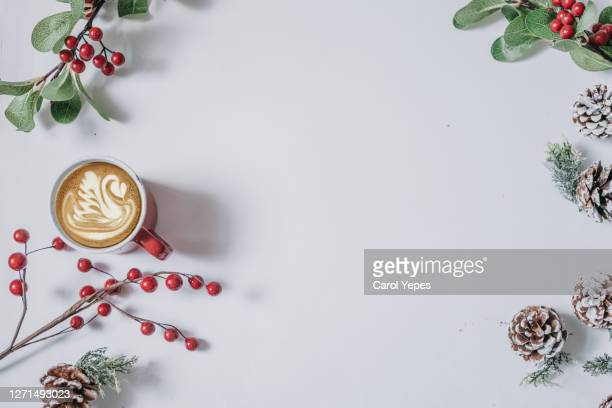 coffee cup with christmas ornaments and decoration on white background - holiday stock pictures, royalty-free photos & images