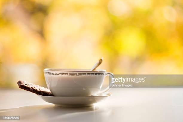 Coffee cup with cookie, still life