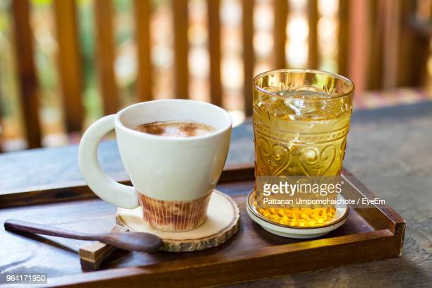 coffee cup with drink glass in tray on table - coffee drink stock pictures, royalty-free photos & images