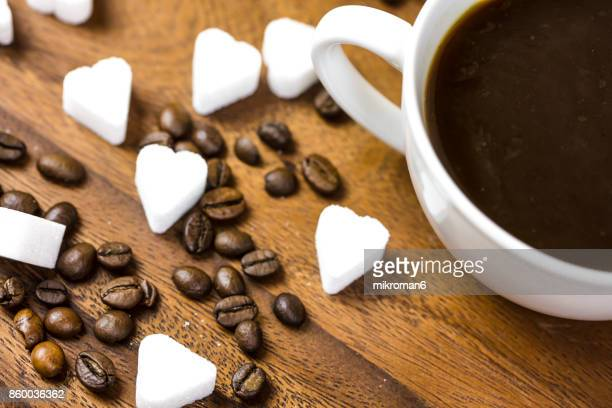 Coffee cup with Heart Shape Sugar Cubes. Sweet dessert