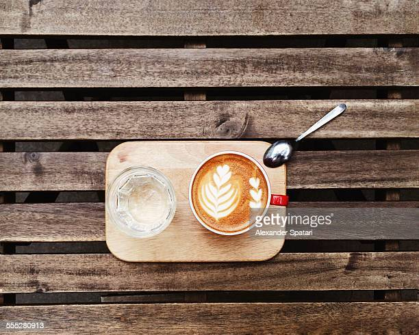 Coffee cup with latte art directly from above