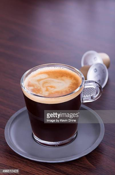 Coffee cup with pods in backgroud