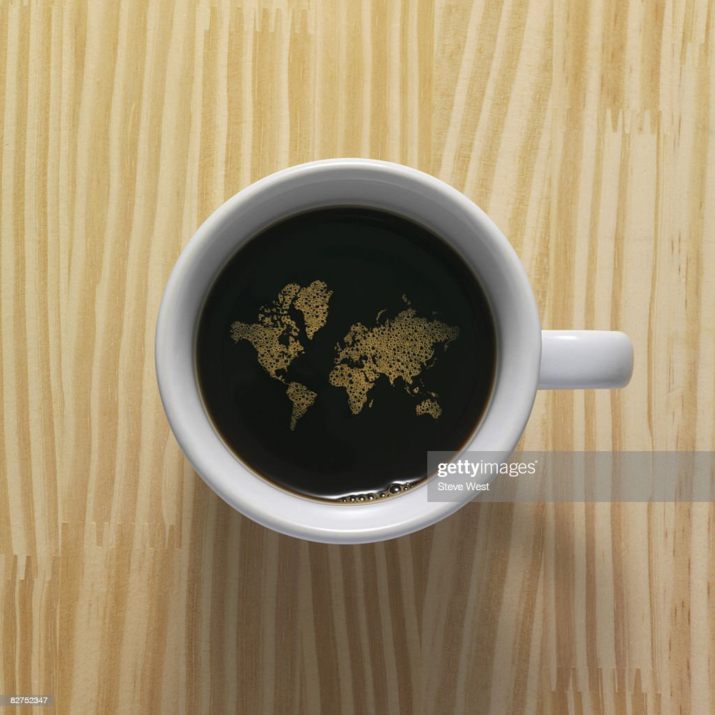 Coffee cup with world map composed of bubbles : Stock Photo