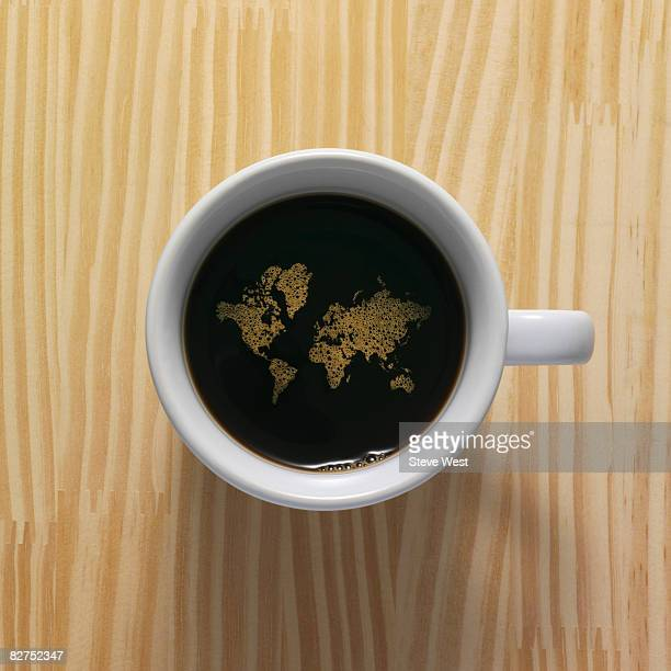 Coffee cup with world map composed of bubbles