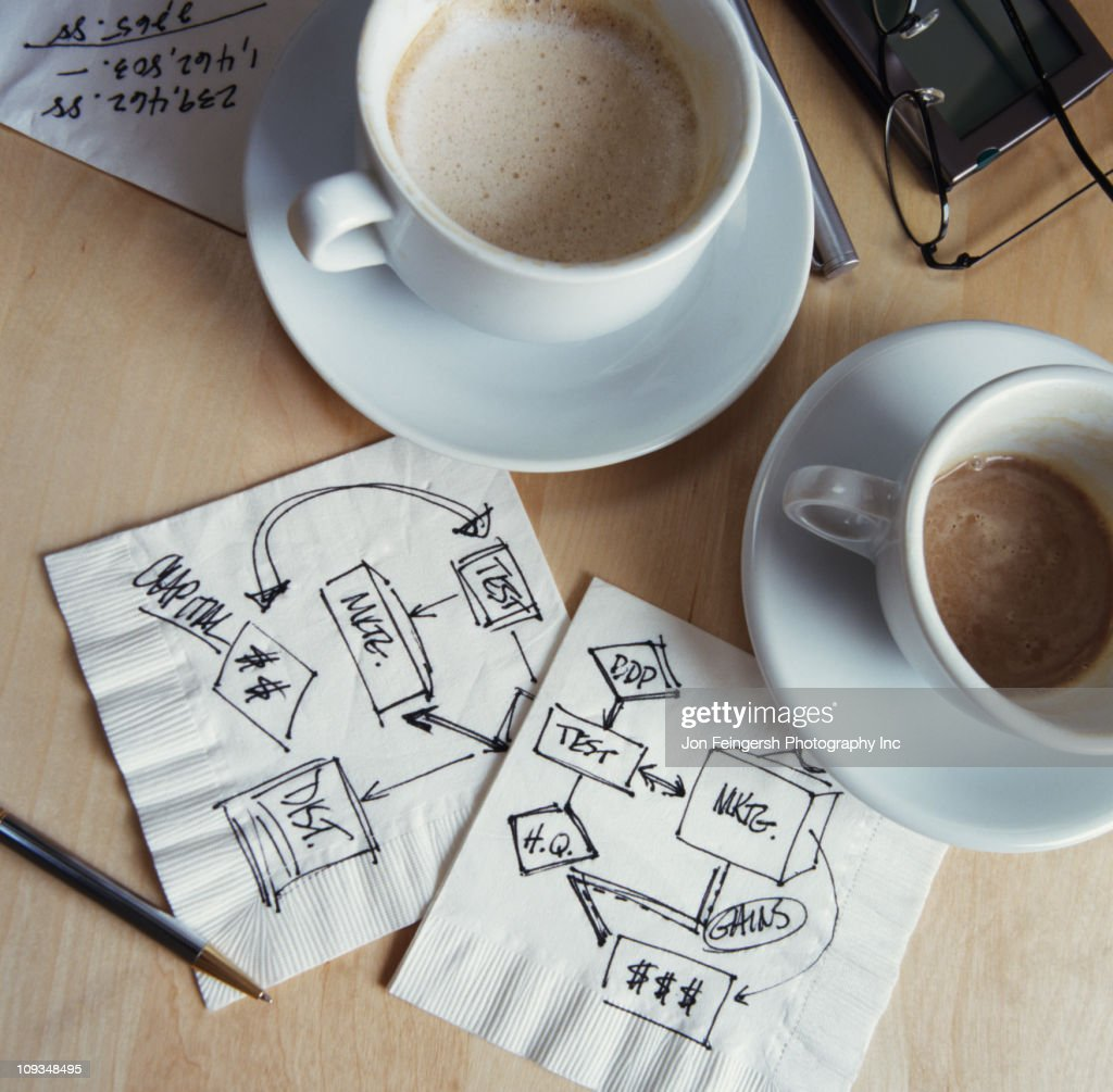 Coffee cups and drawings on napkins : Stock Photo