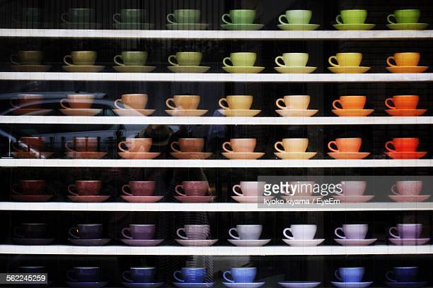 coffee cups arranged on display window for sale in store - neat stock pictures, royalty-free photos & images