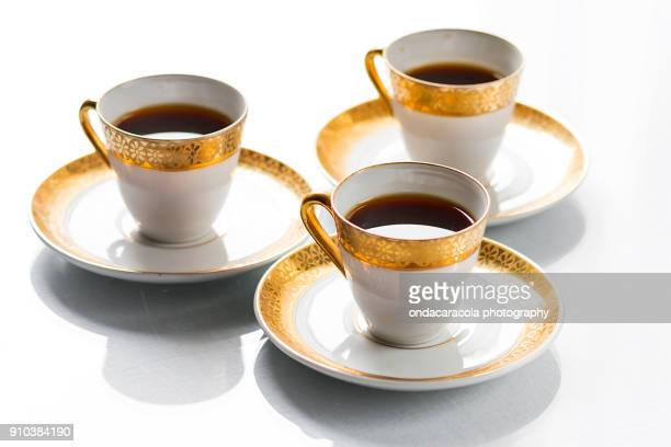 coffee cups of fine limoges porcelain - porcelain stock photos and pictures