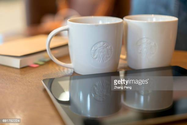 Coffee cups on table while the customers have a break in a Starbucks shop In the second quarter of 2017 Starbucks opened its stores to five new...