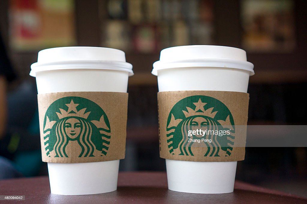 Coffee cups on the table in a Starbucks shop.  Last Thursday... : News Photo