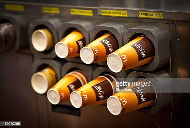 Coffee cups sit in dispensers at a McDonald's Corp restaurant in Little Falls New Jersey US on Wednesday Feb 15 2012 McDonald's Corp the world's...