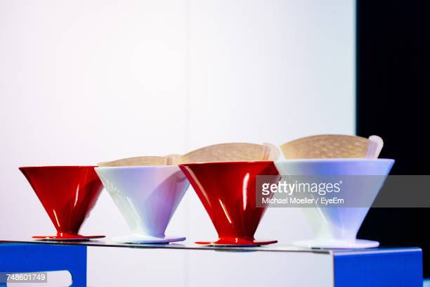 Coffee Cups With Filter Paper On Table At Cafe