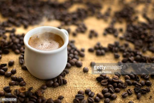 coffee drink in cup on coffee beans background.