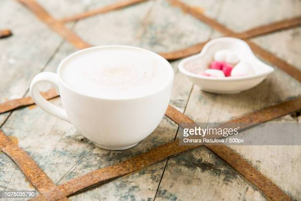 coffee drink in white mug with heart shape sugar - coffee drink stock pictures, royalty-free photos & images