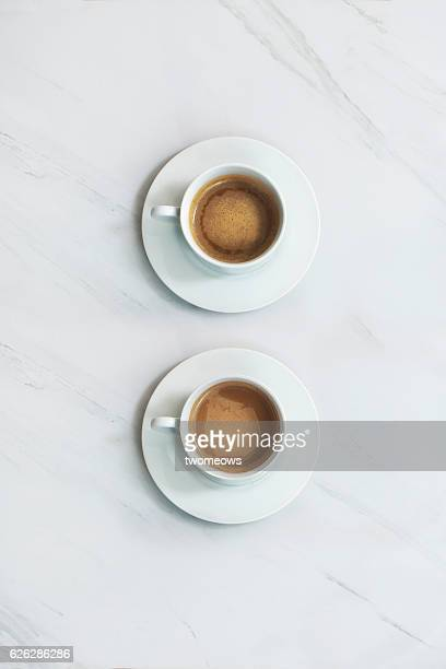 coffee drink on marble table top. - two objects stock photos and pictures