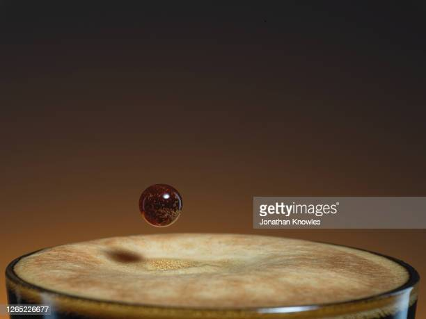 coffee droplet - close up stock pictures, royalty-free photos & images