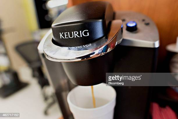 Coffee flows from a Keurig Green Mountain Inc. Machine in this arranged photograph taken at a retail store in Princeton, Illinois, U.S., on Tuesday,...