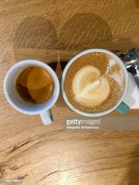 Coffee for two - espresso and cappuccino with heart-shaped froth