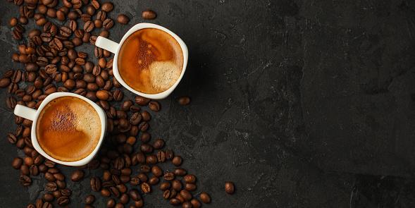 coffee freshly brewed in a white cup serving of beverage (coffee grain). food. top.copy save 1127854034