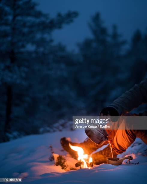 coffee from a wood fire in the forest at winter. - arne jw kolstø stock pictures, royalty-free photos & images