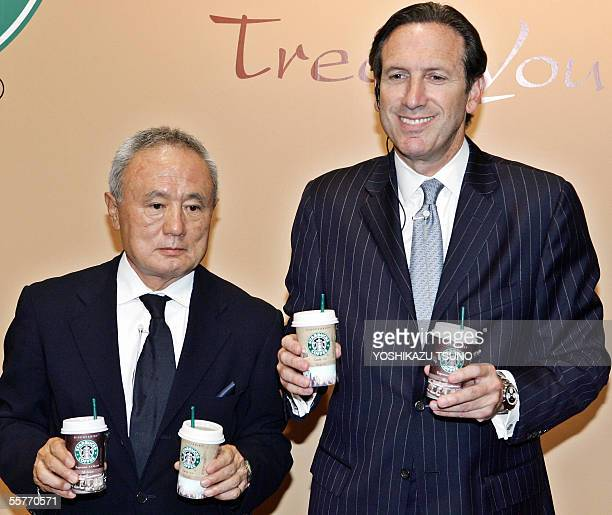 Coffee giant Starbucks Chairman Howard Schultz and Japanese subsidiary President Yuji Tsunoda display chilled packaged coffee drinks called...
