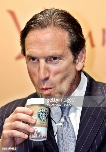 US coffee giant Starbucks Chairman Howard Schultz drinks a chilled packaged coffee drink called 'Starbucks Discoveries' at its launching event at a...