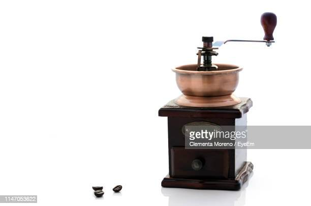 coffee grinder against white background - coffee grinder stock photos and pictures