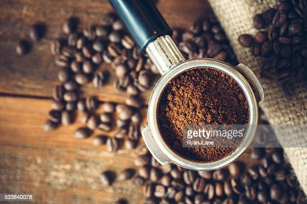 coffee ground in portafilter for espresso - espresso stock photos and pictures