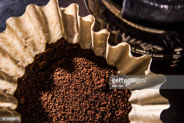 coffee grounds in dripper, java - ground coffee stock photos and pictures