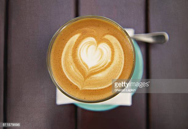 Coffee in a cafe with heart-shaped froth