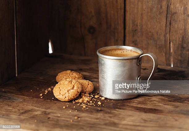 Coffee in aluminum mug with amaretti biscuits