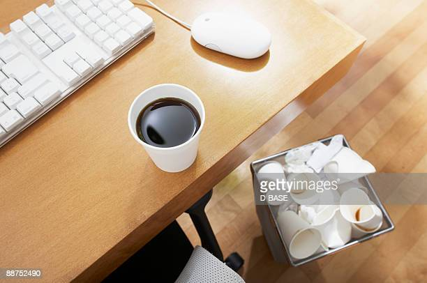 Coffee in disposable cup.