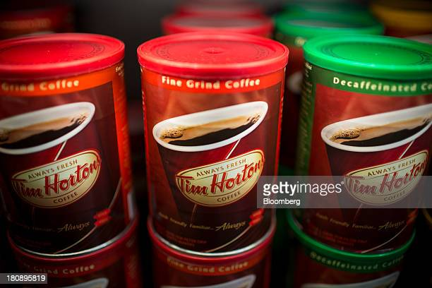 Coffee is displayed for sale on a rack at a Tim Hortons Inc restaurant in Oakville Ontario Canada on Monday Sept 16 2013 Tim Hortons Inc Chief...