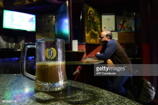 Coffee is picture in a beer mug at Pecos one of Bangalore's oldest pubs on July 4 in the wake of the Indian Supreme Court's ban on selling alcohol...