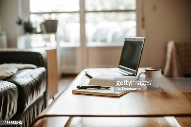 coffee, laptop and a white notebook with a pen ready to work at home - desk stock pictures, royalty-free photos & images