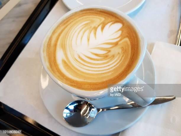 Coffee latte ornate with shape of fern