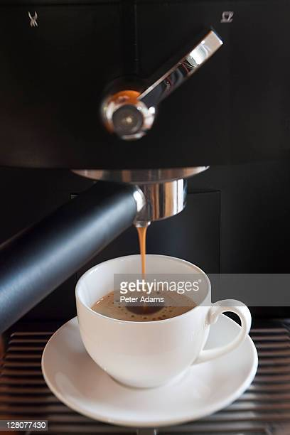 Coffee machine and cup of expresso