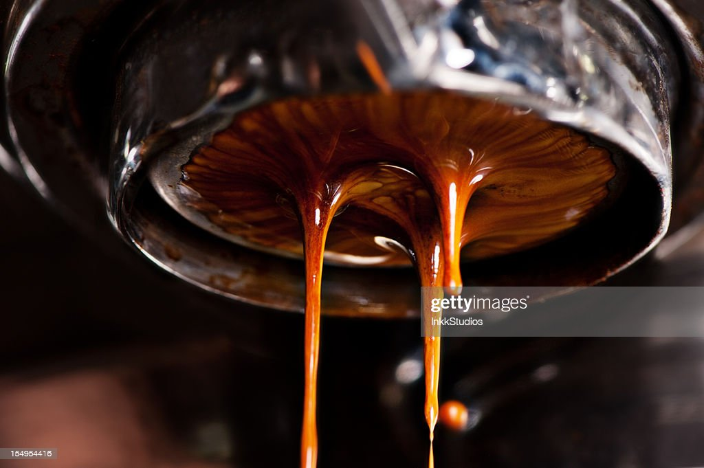 Coffee machine pouring out a cappacino : Stock Photo